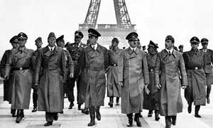 Adolf Hitler at the Eiffel Tower in June 1940