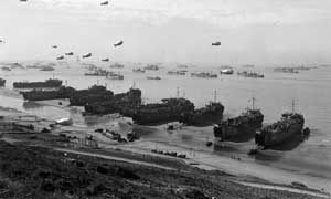 Cargo ships unloading directly on the Omaha Beach