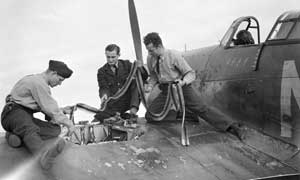 Armourers-replenish-the-ammunition-in-a-Hawker-Hurricane-slider
